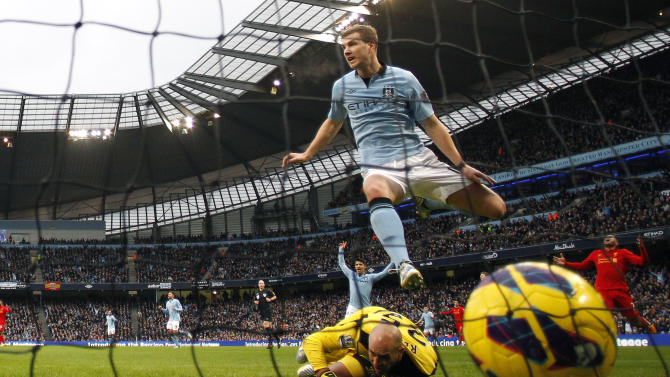 Manchester City's Dzeko celebrates after scoring during their English Premier League soccer match against Liverpool at the Etihad Stadium in Manchester
