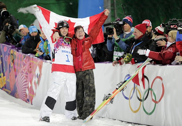 Canada's Alex Bilodeau, left, celebrates with his brother Frederic after winning the gold medal in the men's moguls final at the Rosa Khutor Extreme Park at the 2014 Winter Olympics, Monday, Feb. 10, 2014, in Krasnaya Polyana, Russia. (AP Photo/Andy Wong)