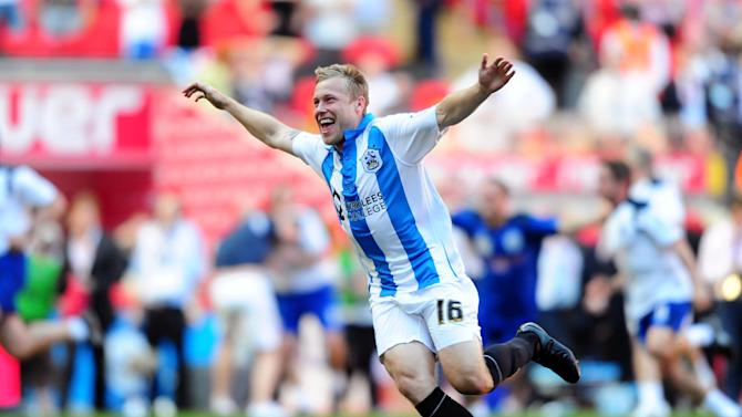 Huddersfield's Scott Arfield could miss the start of the season