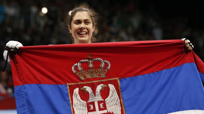 Serbia's Mandic holds a Serbian national flag  after defeating France's Graffe in their women's  67kg gold medal taekwondo final at the ExCel venue during the London 2012 Olympic Games