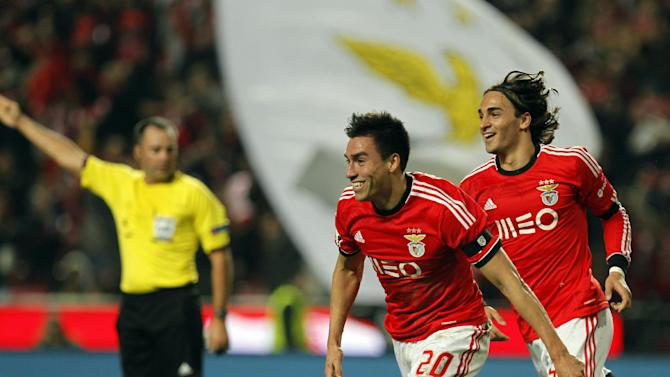 Benfica's Nico Gaitan, from Argentina, celebrates with teammate Lazar Markovic, right, from Serbia, after scoring the opening goal of the game against Sporting during the Portuguese league soccer match between Benfica and Sporting at Benfica's Luz stadium, in Lisbon, Tuesday Feb. 11, 2014