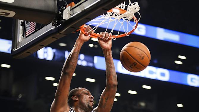 Brooklyn Nets center Andray Blatche (0) dunks as Los Angeles Lakers center Pau Gasol (16), center, looks on in the first quarter of an NBA basketball game at the Barclays Center, Wednesday, Nov. 27, 2013, in New York