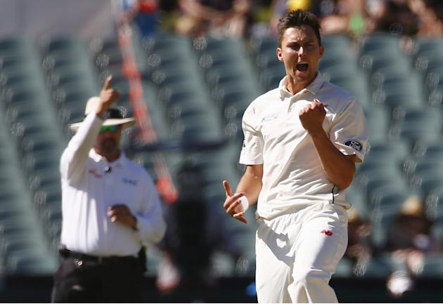 New Zealand's Trent Boult celebrates as umpire Richard Illingworth gives Australia's Joe Burns out LBW for 11 runs during the third day of the third cricket test match at the Adelaide Oval, in