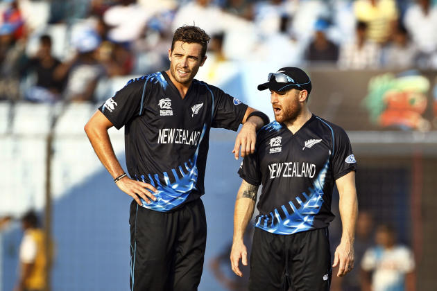 New Zealand's Tim Southee, left, stands with his team captain Brendon McCullum after taking the wicket of South Africa's Albie Morke during their ICC Twenty20 Cricket World Cup match in Chitta