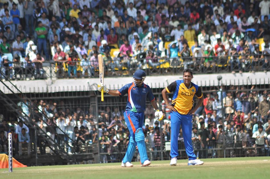 Players during NKP Salve Challenger Trophy between India Blue and Delhi at Holkar Cricket Stadium in Indore on Sept. 26, 2013. (Photo: IANS)