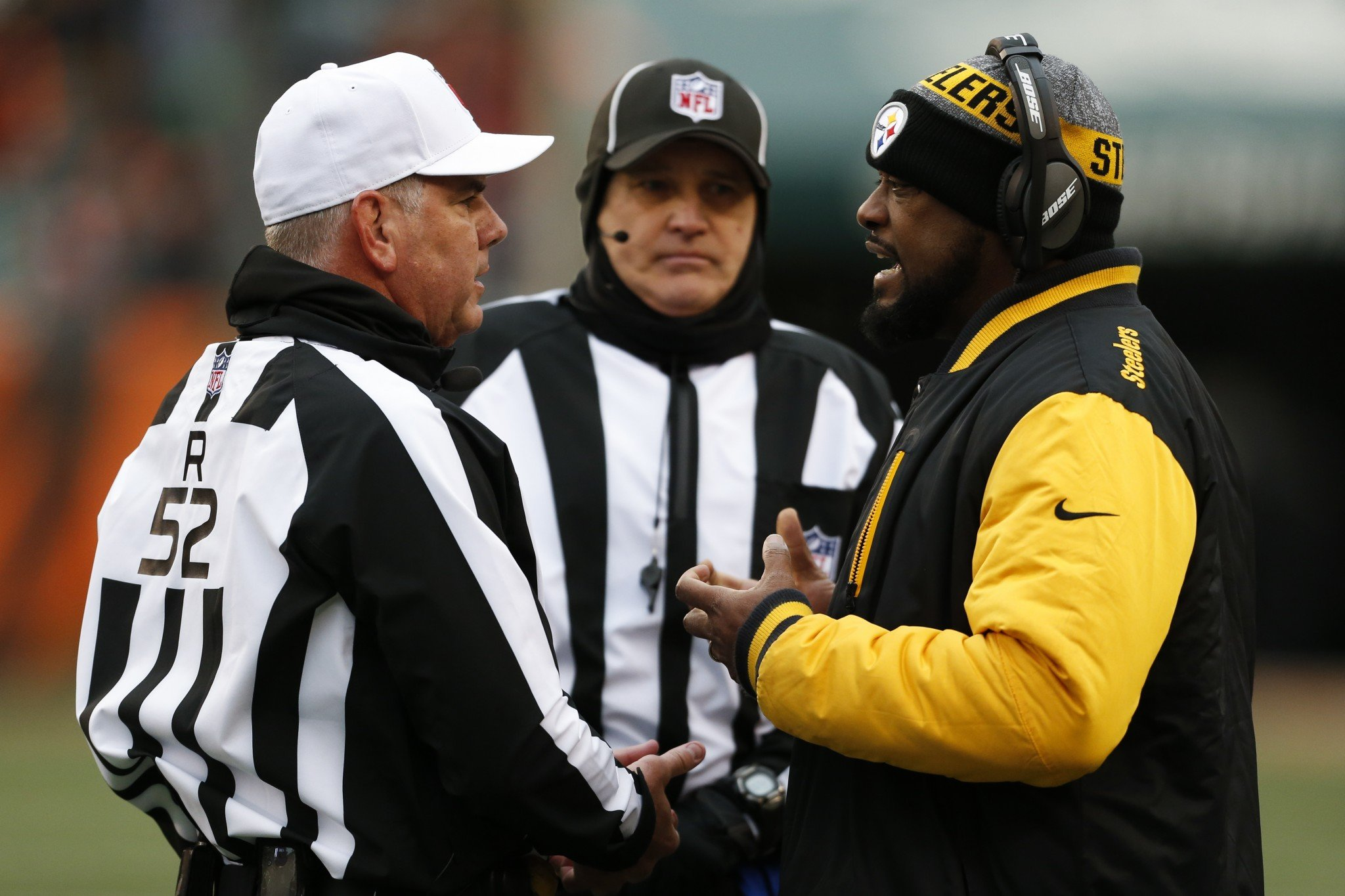 Pittsburgh Steelers head coach Mike Tomlin wants to know how a referee's whistle can freeze. (AP)
