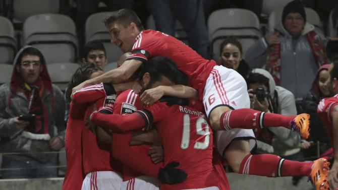 Benfica's Garay celebrates his goal with his teammates during their Portuguese Premier League soccer match against Nacional at Choupana stadium in Funchal