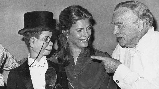 "FILE - This Sept. 30, 1978 file photo shows dummy Charlie McCarthy crossing his legs on the lap of actress Candice Bergen as her father, ventriloquist Edgar Bergen, points at Caesar's Palace Hotel in Las Vegas at Edgar Bergen's farewell performance before his intended retirement.  He died in his sleep later that night. A spokeswoman for Candice Bergen says the actress is developing a film about her late father. Spokeswoman Heidi Schaeffer said Tuesday, April 30, 2013, that the big-screen project will be based on Candice Bergen's 1984 memoir, ""Knock Wood.""  (AP Photo, file)"