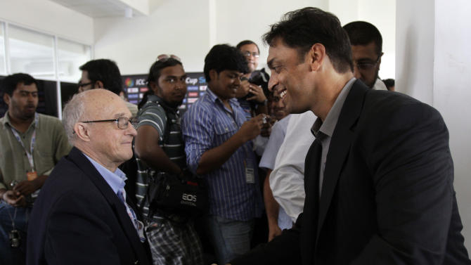 Pakistan's fast bowler Shoaib Akhtar, right, shakes hands with cricket journalist Trevor Chesterfield at the end of a news conference after a training session in Colombo, Sri Lanka, Thursday March 17, 2011. Akhtar will retire from international cricket after the Cricket World Cup, bringing an end to one of the most colorful careers in the sport. (AP Photo/Andres Leighton)