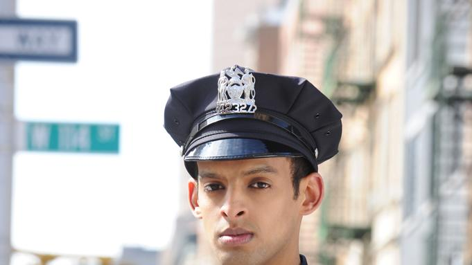 "Tom Reed stars as Officer Ahmand Khan in ""NYC 22."""