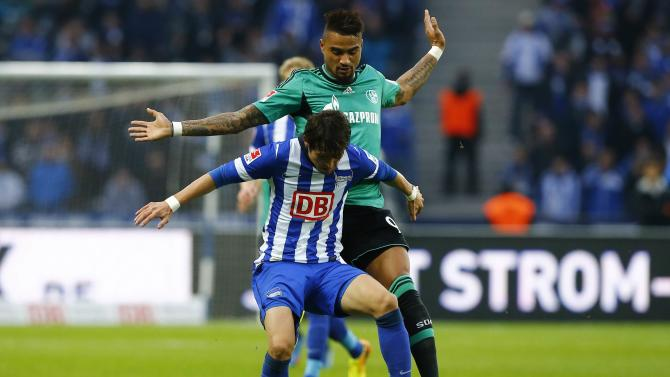 Hertha Berlin's Hajime and Schalke 04's Boateng fight for ball during German first division Bundesliga soccer match in Berlin