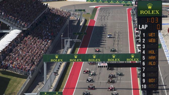 Red Bull Formula One driver Sebastian Vettel of Germany leads as drivers start the Austin F1 Grand Prix at the Circuit of the Americas in Austin, Texas