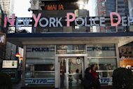 A New York City Police precinct office in Times Square. Sixteen New York Police Department officers pleaded not guilty to charges of widespread fixing of traffic tickets as well as more serious crimes, in the second scandal to hit the force in a week