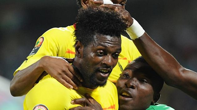 Togo's forward Emmanuel Adebayor celebrates with teammates (Reuters)
