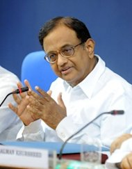 """We have enough friends and we will continue working for the greater good of the economy,"" reformist Finance Minister P. Chidambaram (pictured in August) told reporters on Thursday, indicating Congress had no intention of compromising"