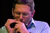 Handout photo from Espafrika shows jazz musician Adam Glasser performing at the Cape Town International Jazz Festival on March 30. He has forged his career in jazz by re-interpreting classics from his native South Africa on his chromatic harmonica