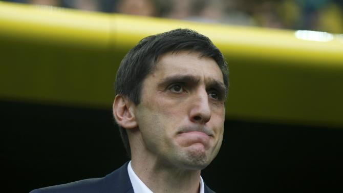 Hanover 96's coach Korkut reacts before the German Bundesliga first division soccer match against Borussia Dortmund in Dortmund