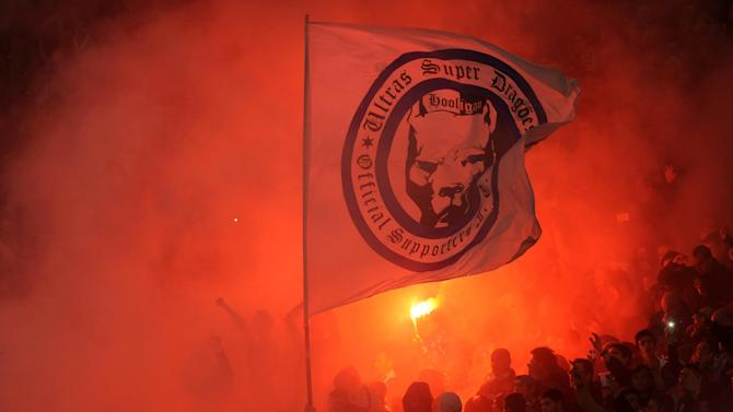 FC Porto's fans light flares on the stands prior to their match with Benfica in a Portugal Cup semifinal first leg soccer match at the Dragao stadium in Porto, Portugal, Wednesday, March 26, 2014