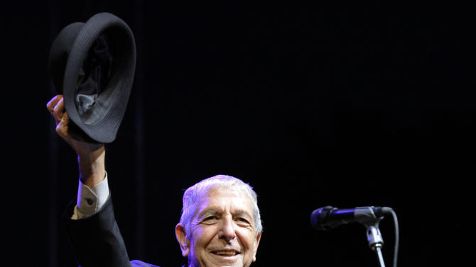 "FILE - In this April 17, 2009 file photo, Leonard Cohen salutes the crowd during his performance on the first day of the Coachella Valley Music & Arts Festival in Indio, Calif. It's hard to think of any song that has taken a stranger journey through popular culture than Leonard Cohen's ""Hallelujah."" Author Alan Light's book, ""The Holy or the Broken,"" releasing on Dec. 4, 2012, is about the trajectory of the song, ""Hallelujah,"" and about Cohen and its most celebrated singer, the late Jeff Buckley. (AP Photo/Chris Pizzello, File)"