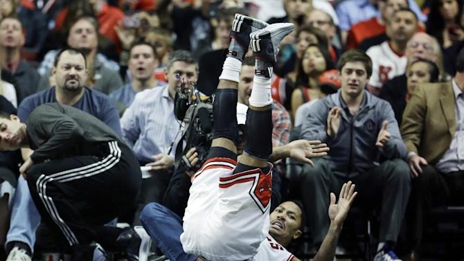 Chicago Bulls guard Derrick Rose falls down during the first half of an NBA preseason basketball game against the Detroit Pistons in Chicago on Wednesday, Oct. 16, 2013
