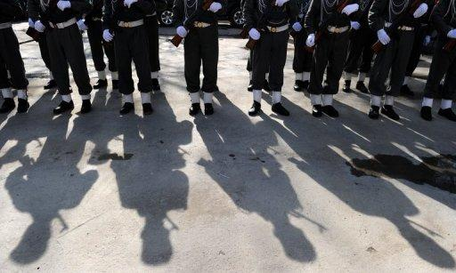 "This file photo shows Afghan police standing to attention during a ceremony at the main police headquarters in Kabul, on January 25, 2010. A female Afghan police officer on Monday shot dead a foreign civilian adviser in Kabul police HQ, in the first ""insider"" attack to be carried out by a woman."