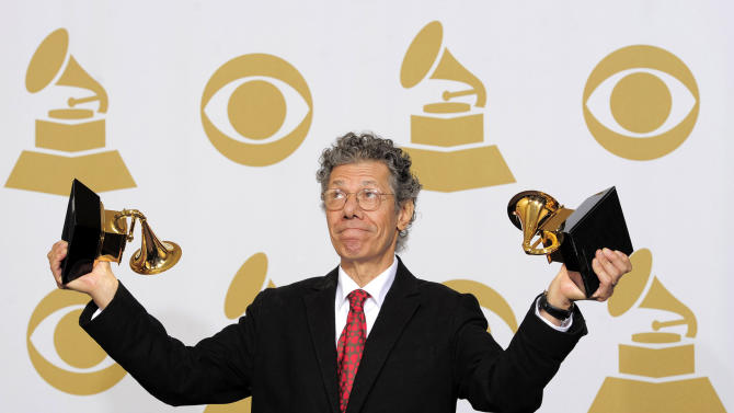 "FILE - This Feb. 12, 2012 file photo shows Chick Corea poses backstage with the awards for best improvised jazz solo for ""500 Miles High"" and best jazz instrumental album for ""Forever"" at the 54th annual Grammy Awards in Los Angeles. Last year, the 71-year-old jazz pianist and composer released four major recordings covering a wide gamut of music _ electric and acoustic, originals and standards, everything from solo piano improvisations to a concerto for jazz quintet and chamber orchestra. (AP Photo/Mark J. Terrill, file)"