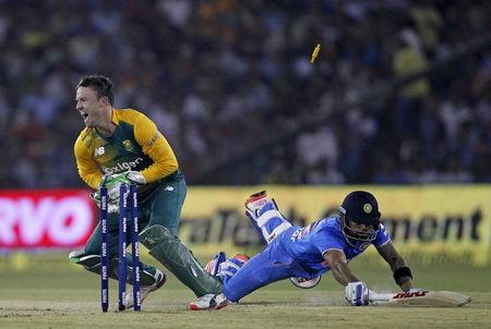 India's Virat Kohli dives to make the crease as he is run out by South Africa's AB de Villiers during their second Twenty20 cricket match in Cuttack