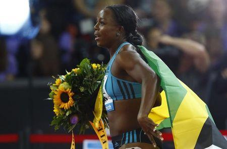 First placed Campbell-Brown of Jamaica celebrates after the women's 100m event during the Weltklasse Diamond League meeting at the Letzigrund stadium in Zurich