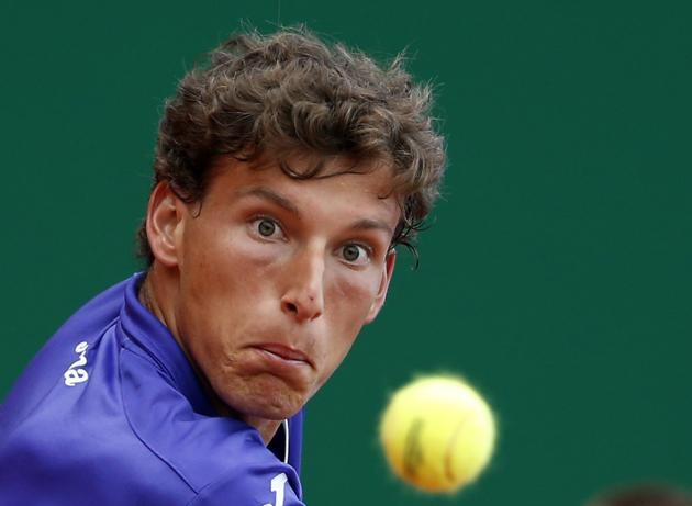 Carreno-Busta of Spain returns the ball to Monfils of France during the Monte Carlo Masters in Monaco