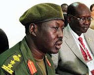 Sudan People's Liberation Army (SPLA) spokesman Colonel Philip Aguer (L) and South Sudan government spokesman Barnaba Marial Benjamin give a press conference in Juba, South Sudan. Sudanese warplanes launched fresh air raids on oil-rich areas of South Sudan, a Southern official said, as their bilateral relations frayed despite UN chief Ban Ki-moon calling for calm