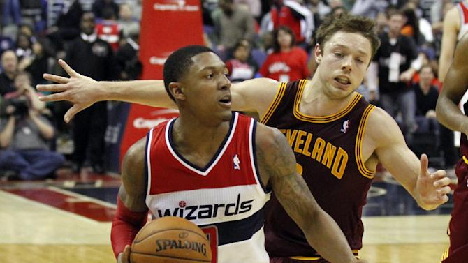 Washington Wizards guard Bradley Beal, left, gets past Cleveland Cavaliers guard Matthew Dellavedova in overtime of an NBA basketball game on Saturday, Nov. 16, 2013, in Washington. The Cavaliers won 103-96 in overtime