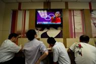 Coverage of the London 2012 Olympics is shown on a television screen at a fast-food restaurant in Beijing, on August 2. The London Olympics began July 27 and runs until August 12, with teams from 205 countries competing