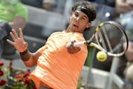 Spain's Rafael Nadal returns a ball during his quarter-finals match against Czech Republic's Tomas Berdych at the ATP Rome tournament. Nadal won 6-4, 7-5
