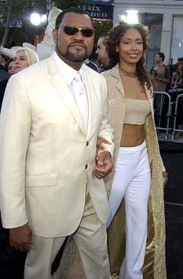 Premiere: Laurence Fishburne and Gina Torres go for a leisurely stroll down the black carpet at the Hollywood premiere of Warner Brothers' The Matrix: Reloaded - 5/7/2003