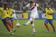 Ecuador's Frickson Erazo tries to block a shot from Peru's Paolo Guerrreo (R) during their Brazil 2014 World Cup South American qualifier match at the National Stadium in Lima on June 7, 2013. Peru won 1-0