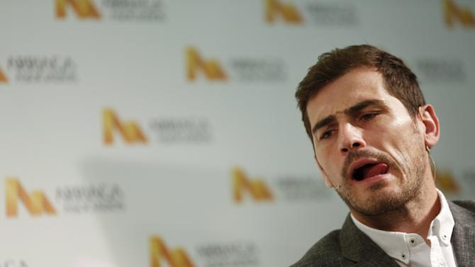 Spain's goalkeeper Iker Casillas reacts during a news conference in Madrid