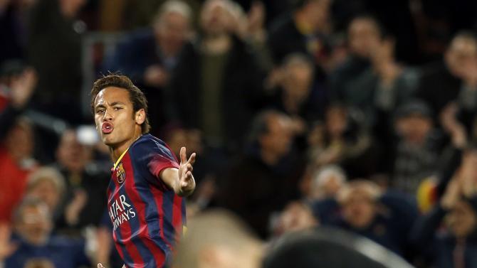 Barcelona's Neymar celebrates a goal against Rayo Vallecano goalkeeper Ruben during their Spanish first division soccer match in Barcelona