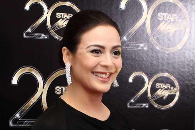 Dawn Zulueta opted for a neatly pulled look.