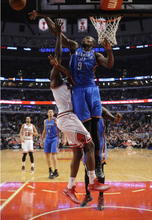 Oklahoma City Thunder forward Serge Ibaka (9) blocks the shot of Chicago Bulls forward Tony Snell, left, during the first half of an NBA basketball game, Thursday, March 5, 2015 in Chicago.  (AP Photo