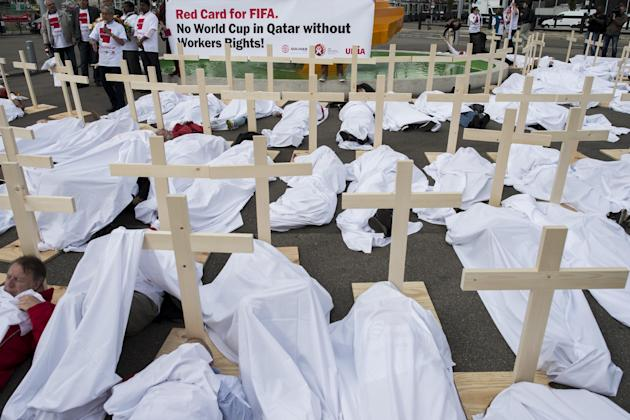 "Activists have set up wooden crosses during a protest called ""Red Card for FIFA. No World Cup in Qatar without Workers rights!"" that was organized by the Swiss trade union UNIA in front of t"