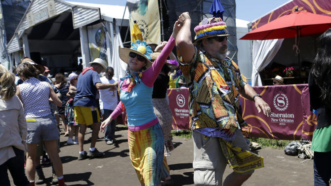 David and Lisa Wurtzel, of New Orleans, dance as the Savoy Family Cajun Band performs at the New Orleans Jazz and Heritage Festival in New Orleans, Sunday, May 5, 2013. (AP Photo/Gerald Herbert)