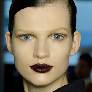 Model at Bottega Veneta AW12 backstage wearing berry lips