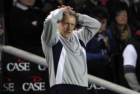 Neil Warnock reacts during a FA Cup soccer match against Milton Keynes Dons at stadiummk, Milton Keynes, central England, January 7, 2012. REUTERS/Eddie Keogh/Files