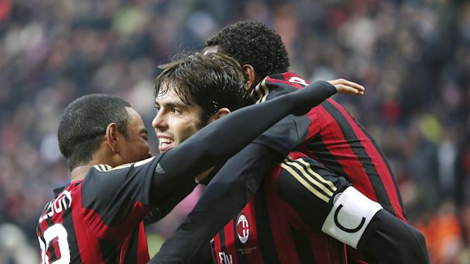 AC Milan Brazilian forward Kaka, center, celebrates with his teammates Brazilian forward Robinho, right, and Urby Emanuelson, of the Netherlands,  after scoring during the Serie A soccer match between AC Milan and Atalanta at the San Siro stadium in Milan, Italy, Monday, Jan. 6, 2014