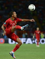 Portuguese midfielder Nani controls the ball during the Euro 2012 football championships match Portugal vs. Netherlands at the Metalist stadium in Kharkiv. Portugal beat the Netherlands 2-1 on Sunday to set up a Euro 2012 quarter-final with the Czech Republic and condemn the Dutch to a first group-stage European Championship exit since 1980