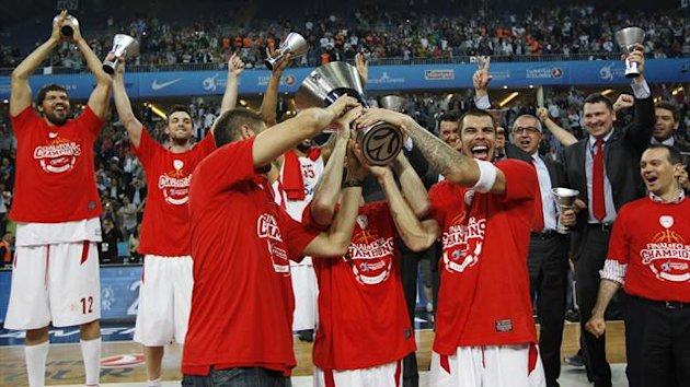 Olympiacos' players hold up the trophy after winning the Euroleague Final Four final basketball game against CSKA Moscow in Istanbul