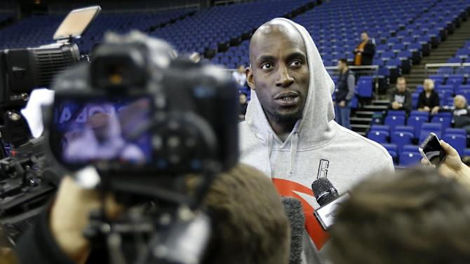 Brooklyn Nets player Kevin Garnett listens to media questions during a training session at the O2 Arena in London, Wednesday, Jan. 15, 2014. The Atlanta Hawks will play the Brooklyn Nets in an NBA match at the O2 Arena on Thursday