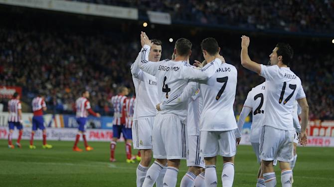 Real's Cristiano Ronaldo, centre, (7), cerebrates his goal with teammates during a semi final, 2nd leg, Copa del Rey soccer match between Atletico de Madrid and Real Madrid at the Vicente Calderon stadium in Madrid, Spain, Tuesday, Feb. 11, 2014