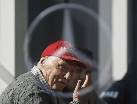 Former Formula One driver Lauda of Germany is pictured speaking though a Mercedes logo during testing session at the Catalunya racetrack in Montmelo