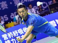 Lin Dan of China returns a shot against Rajiv Ouseph of England during their Group A match at the Thomas Cup world badminton team championships in Hubei province. Superstar Lin was made to sweat in front of an adoring home crowd but China breezed through their first group ties in the tournament
